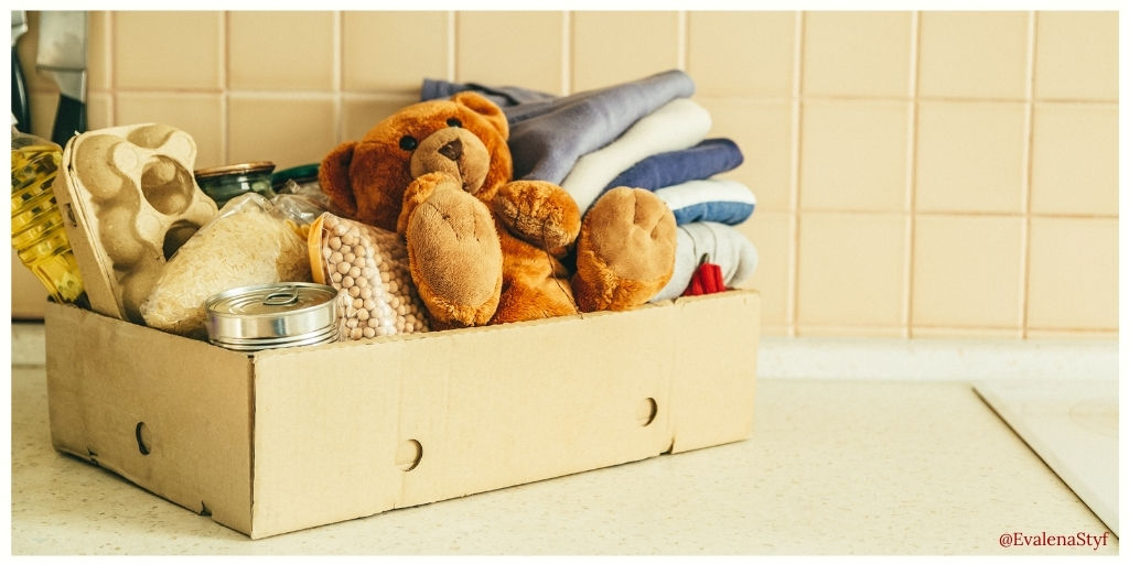 Be charitable: A box of food, clothes and toys to be donated